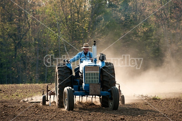Farmer working up new field.