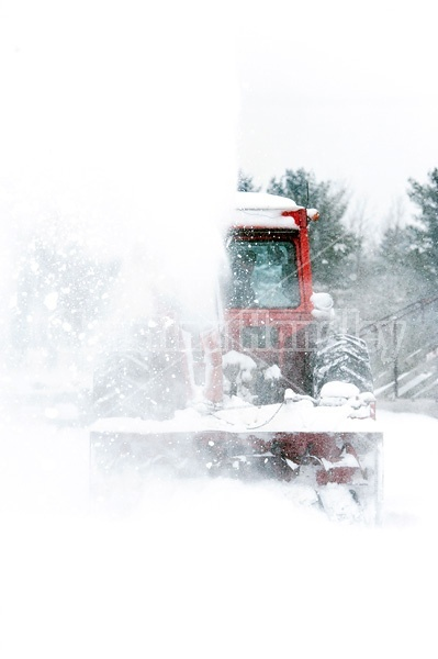 Snow blowing with tractor and snow blower