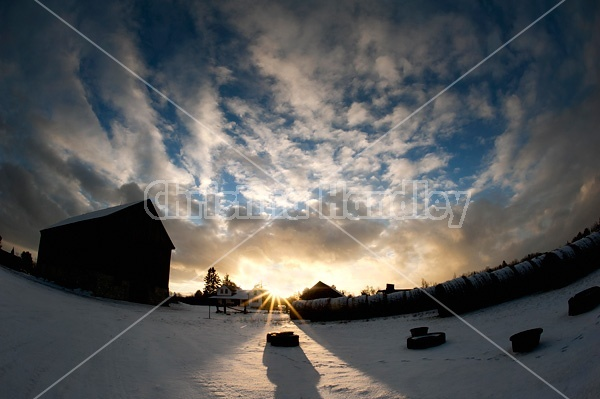 Winter barnyard in the evening setting sun