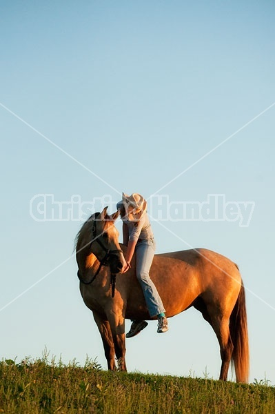 Teenage girl riding bareback