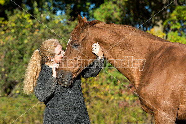 Woman with her Thoroughbred horse