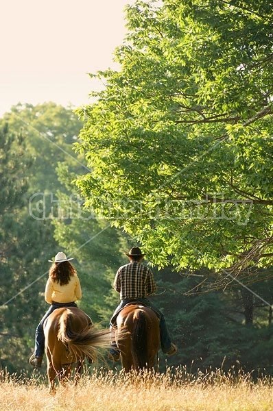 Husband and Wife Trail Riding Together