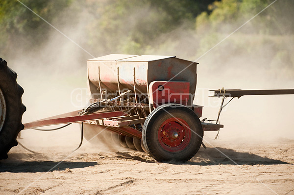 Seed drill being pulled by tractor
