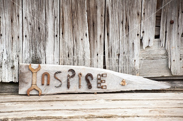 Hand crafted Inspire art sign made out of wood and recycled or repurposed farm tools and machinery parts