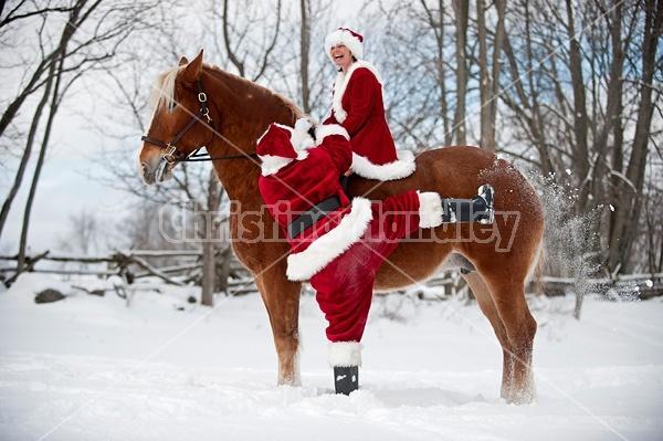 Santa Claus and Mrs. Claus horseback riding