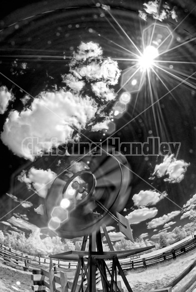 Funky photo of a windmill taken with a slow shutter speed to imply motion. Photographed in infrared with a fisheye lens.