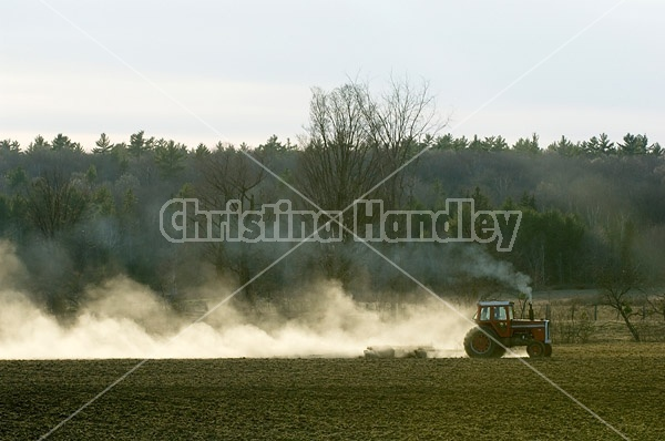 Farmer working a field in the springtime