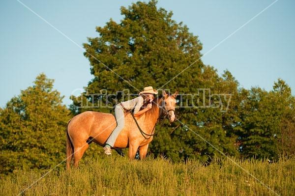 Teenage girl riding bareback