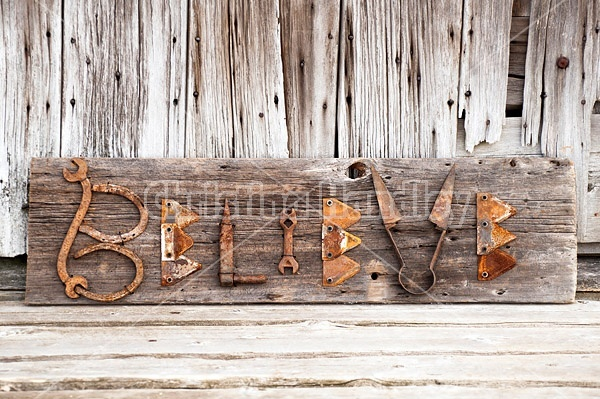 Hand crafted Believe art sign made out of wood and recycled or repurposed farm tools and machinery parts