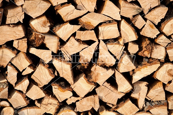 Firewood cut, split and stacked