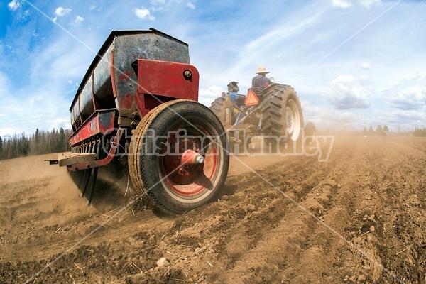 Farmer seeding oats in the springtime