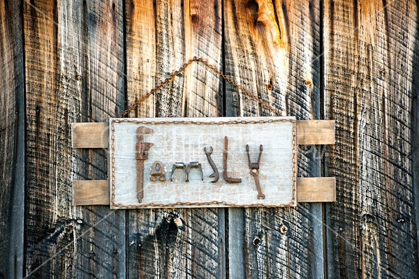 Hand crafted garden art sign made with recycyled and repurposed tools and old farm machinery parts