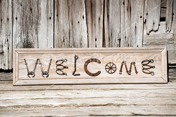 Hand crafted Welcome art sign made out of wood and recycled or repurposed farm tools and machinery parts
