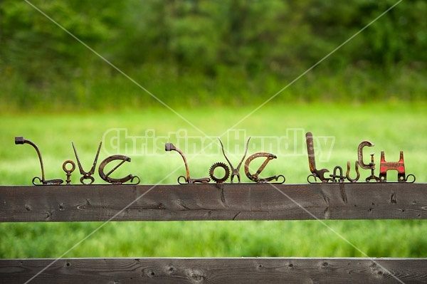 Hand crafted live love laugh garden art signs made out of recycled or repurposed farm tools and machinery parts then welded together