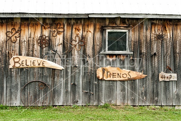 Hand crafted garden art signs made out of wood and recycled or repurposed farm tools and machinery parts