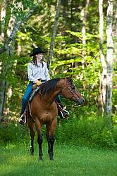 Young woman riding an American Quarter Horse gelding