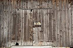 Hand made Hope garden art sign hanging on a barn wall