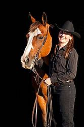 Portrait of a young woman and her American Paint Horse mare