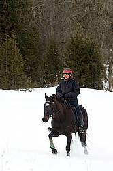 Woman horseback riding in the winter
