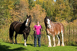Portrait of a woman and her two horses