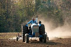 Farmer working up new field.