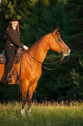 Young woman riding her American Paint horse mare
