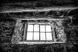 Spooky barn window