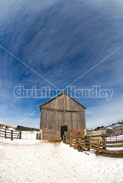 Barn and blue sky in the winter.