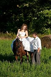Bride and groom with horse