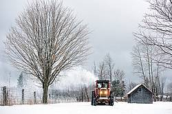 Farmer blowing snow out of driveway