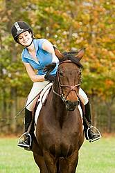 Young woman horseback riding