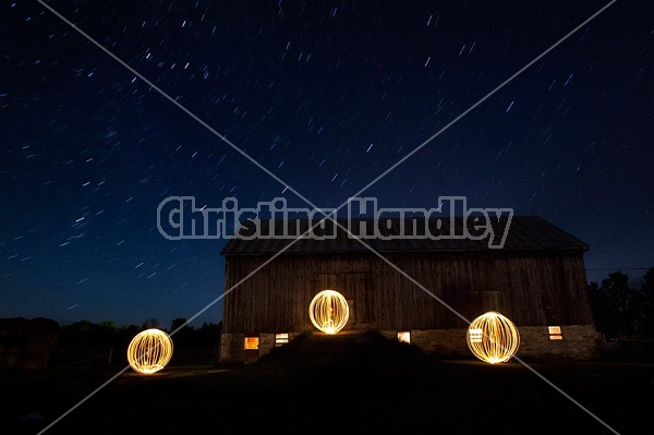 Light painting at night in front of big barn