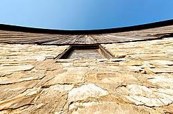 Looking up at an old barn wall