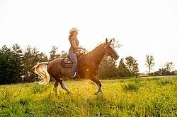 Young woman horseback riding western