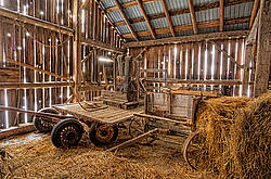 Old wagons in hayloft of old style barn