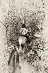 Photo of two women riding double