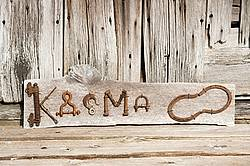 Hand crafted Karma art sign made out of wood and recycled or repurposed farm tools and machinery parts