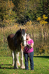 Portrait of a woman with her Clydesdale draft horse