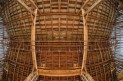 Looking straight up at the ceiling and rafters of the hayloft in an old style barn