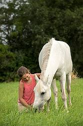 Portrait of a young girl with a gray pony