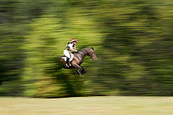 Woman riding cross country