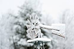 Windmill frozen with ice and snow