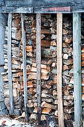 Chopped firewood stacked in shed