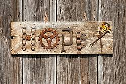 Hand crafted garden art sign made out of wood and recycled or repurposed farm tools and machinery parts