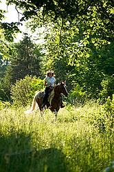 Woman riding Spotted Saddle Horse