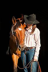 Portrait of a young woman and her American Quarter Horse gelding