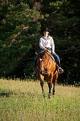 Young woman trail riding in Ontario Canada