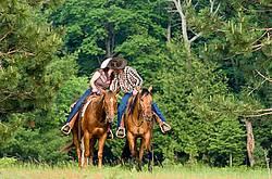 Young couple horseback riding