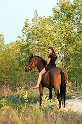 Young woman horseback riding bareback