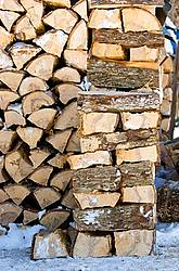Hardwood firewood cut, split and piled